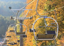 13th Lift seat in the sky. 13th (devils number) lift seat in autumn, before skiing season royalty free stock images