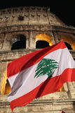 Flag of Lebanon in front of Colosseum during Way of the Cross royalty free stock photos