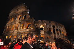 Crowd in front of Colosseum during Way of the Cross in Rome Stock Photo
