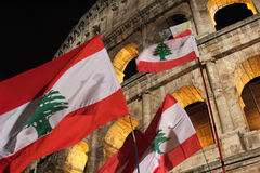Flags of Lebanon in front of Colosseum during Way of the Cross Stock Photo
