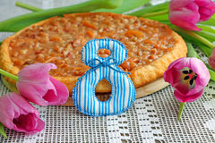 8th of March. Delicious caramel tart and tulips Royalty Free Stock Photography
