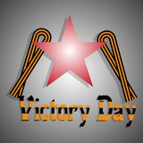 9th May Victory Day. Vector illustration. A congratulatory inscription, a St.George`s Ribbon and a star on a gray background with a gradient royalty free illustration