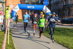 12th New Year's Eve Race in Krakow. The people running dressed in funny costumes Stock Photo