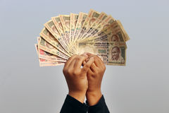 9th November, 2016, India- A unidentified boy took some Indian currency in the air. Stock Photography