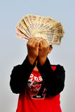 9th November, 2016, India- A unidentified boy took some Indian currency in the air. Stock Photos