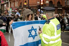 National Demo: Justice Now - Make it right for Palestine London. 4th November 2017, London, United Kingdom:-Pro Israeli protester confronts a metropolitan police Royalty Free Stock Photos