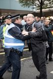National Demo: Justice Now - Make it right for Palestine London. 4th November 2017, London, United Kingdom:-Unidentified protester scuffles with a police officer Stock Images