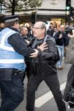National Demo: Justice Now - Make it right for Palestine London. 4th November 2017, London, United Kingdom:-Unidentified protester scuffles with a police officer Royalty Free Stock Photo
