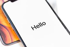 12th October,2018-Kiev,Ukraine: Latest Iphone XS on opened box on white table. Newest Apple smartphone on white branded. Box in mobile store. Edge frameless royalty free stock images