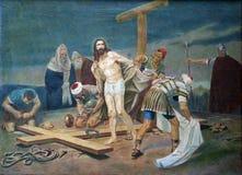 10th station av korset - Jesus rivs av av hans plagg Royaltyfri Bild