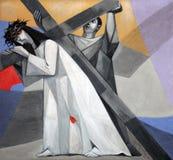 5th stationer av korset, Simon av Cyrene bär korset Arkivbild