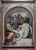 14th Stations of the Cross, Jesus is laid in the tomb and covered in incense. Basilica of the Sacred Heart of Jesus in Zagreb, Croatia royalty free stock image