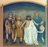 10th Stations of the Cross, Jesus is stripped of His garments. Church of the Blessed Aloysius Stepinac in Budasevo, Croatia Royalty Free Stock Photo