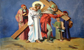5th Stations of the Cross, Simon of Cyrene carries the cross. Church of St. Aloysius in in Travnik, Bosnia and Herzegovina on June 11, 2014 Royalty Free Stock Image