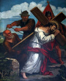 5th Stations of the Cross, Simon of Cyrene carries the cross Royalty Free Stock Images