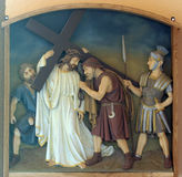5th Stations of the Cross, Simon of Cyrene carries the cross. Church of the Blessed Aloysius Stepinac in Budasevo, Croatia Royalty Free Stock Photography
