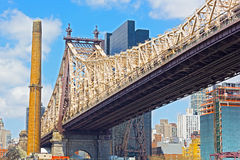 59th Street Bridge and chimney nearby. Royalty Free Stock Photo