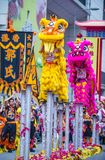 The 14th Tai Kok Tsui temple fair in Hong Kong. HONG KONG - MARCH 04 : Lion dance performance during the 14th Tai Kok Tsui temple fair in Hong Kong on March 04 Royalty Free Stock Photo