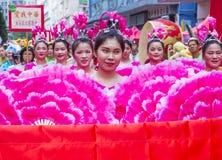 The 14th Tai Kok Tsui temple fair in Hong Kong. HONG KONG - MARCH 04 : Participants in the 14th Tai Kok Tsui temple fair in Hong Kong on March 04 2018. The Royalty Free Stock Photos