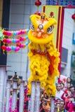 The 14th Tai Kok Tsui temple fair in Hong Kong. HONG KONG - MARCH 04 : Lion dance performance during the 14th Tai Kok Tsui temple fair in Hong Kong on March 04 Stock Photo