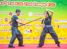The 14th Tai Kok Tsui temple fair in Hong Kong. HONG KONG - MARCH 04 : Martial arts demonstration during the 14th Tai Kok Tsui temple fair in Hong Kong on March Stock Photography