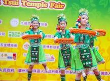 The 14th Tai Kok Tsui temple fair in Hong Kong. HONG KONG - MARCH 04 : Participants in the 14th Tai Kok Tsui temple fair in Hong Kong on March 04 2018. The Royalty Free Stock Image