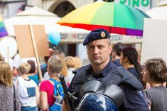 15th Zagreb pride. Intervention policeman in front of LGBTIQ activists on Ban Josip Jelacic square. ZAGREB, CROATIA - JUNE 11, 2016: 15th Zagreb pride stock images