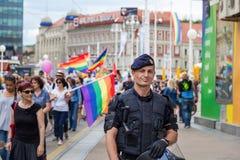 15th Zagreb pride. Intervention policeman in front of LGBTIQ activists on Ban Josip Jelacic square. ZAGREB, CROATIA - JUNE 11, 2016: 15th Zagreb pride royalty free stock images
