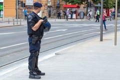 15th Zagreb pride. Intervention policeman standing in the street. ZAGREB, CROATIA - JUNE 11, 2016: 15th Zagreb pride. Intervention policeman standing in the royalty free stock photos