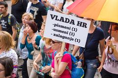 15th Zagreb pride. LGBTIQ activist holding banner. ZAGREB, CROATIA - JUNE 11, 2016: 15th Zagreb pride. LGBTIQ activist holding banner stock photo