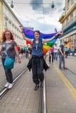 15th Zagreb pride. LGBTIQ activist holding flag. ZAGREB, CROATIA - JUNE 11, 2016: 15th Zagreb pride. LGBTIQ activist holding flag stock images