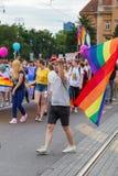 15th Zagreb pride. LGBTIQ activist holding flag. ZAGREB, CROATIA - JUNE 11, 2016: 15th Zagreb pride. LGBTIQ activist holding flag stock photo
