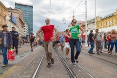 15th Zagreb pride. LGBTIQ activists dancing at the main square. ZAGREB, CROATIA - JUNE 11, 2016: 15th Zagreb pride. LGBTIQ activists dancing at the main square stock photo