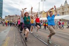 15th Zagreb pride. LGBTIQ activists dancing at the main square. ZAGREB, CROATIA - JUNE 11, 2016: 15th Zagreb pride. LGBTIQ activists dancing at the main square royalty free stock images