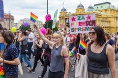 15th Zagreb pride. LGBTIQ activists passing by Croatian National Theater. ZAGREB, CROATIA - JUNE 11, 2016: 15th Zagreb pride. LGBTIQ activists passing by royalty free stock image