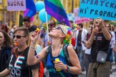 15th Zagreb pride. LGBTIQ activists on street. ZAGREB, CROATIA - JUNE 11, 2016: 15th Zagreb pride. LGBTIQ activist blowing soap bubbles stock images