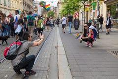 15th Zagreb pride. LGBTIQ activists taking photos. ZAGREB, CROATIA - JUNE 11, 2016: 15th Zagreb pride. LGBTIQ activists taking photos Stock Photo