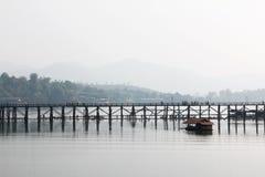 Tha bridge cross the lake. The wood bridge cross the lake, Sankraburi, Thailand Stock Photography