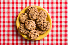 Chocolate cookies on checkered tablecloth Stock Images