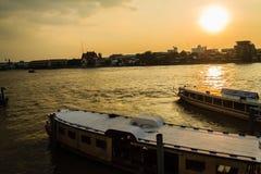 Tha Maharaj boat pier in the evening on Chao Phaya river nearby Royalty Free Stock Photo