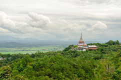 Tha Ton Temple set amid green mountain in Thailand Stock Photo