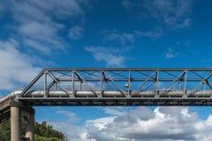 Thackeray Street pipeline bridge over Parramatta River, Australi. Parramatta, Australia - March 24, 2017: Closeup of part of Thackeray Street gray metal pipeline Stock Photo