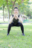 Thai adult beautiful girl doing yoga exercises in the park Royalty Free Stock Photos