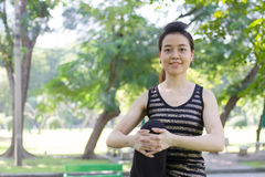 Thai adult beautiful girl doing yoga exercises in the park Stock Photos