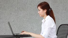 Thai adult businesswoman beautiful girl using computer notebook. Portrait of thai adult businesswoman beautiful girl using computer notebook stock footage
