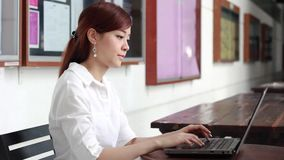 Thai adult businesswoman beautiful girl using computer notebook. Portrait of thai adult businesswoman beautiful girl using computer notebook stock video footage