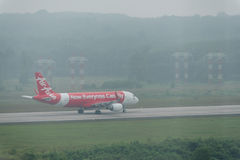 Thai Air asia airline taxi in haze at krabi airport Royalty Free Stock Images