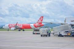 Thai Air Asia plane. Chiangmai, Thailand - September 06, 2016 : Thai Air Asia plane loading baggage and ready to fly at Chiangmai airport, Chiangmai,Thailand on Stock Photos