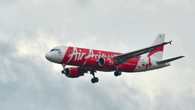Thai AirAsia Airbus 320 landing at Changi Airport Royalty Free Stock Photo