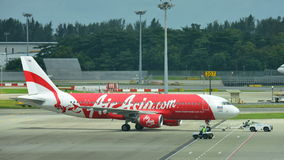 Thai AirAsia Airbus 320 ready for push back. SINGAPORE - JANUARY 10: Thai AirAsia Airbus 320 ready for push back at Changi Airport on January 10, 2015 in Stock Image